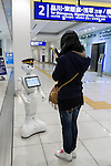 A woman takes a picture of SoftBank's humanoid robot Pepper on its first day as a new member of staff for the Keikyu Line railway at Haneda International Terminal station on November 28, 2015, Tokyo, Japan. Pepper is programmed to interact with Japanese and foreign commuters and to introduce Keiyu Line information. (Photo by Rodrigo Reyes Marin/AFLO)