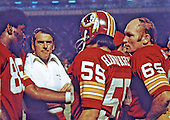 Washington Redskins head coach and general manager George Allen talks strategy with members of his team on the sidelines during the game against the St. Louis Cardinals at RFK Stadium in Washington, DC on September 22, 1974.  The Cardinals won the game 17 - 10. From left to right: left linebacker Dave Robinson (89), Coach Allen, right linebacker Chris Hanburger (55), and offensive guard Fred Sturt (65).<br /> Credit: Arnie Sachs / CNP