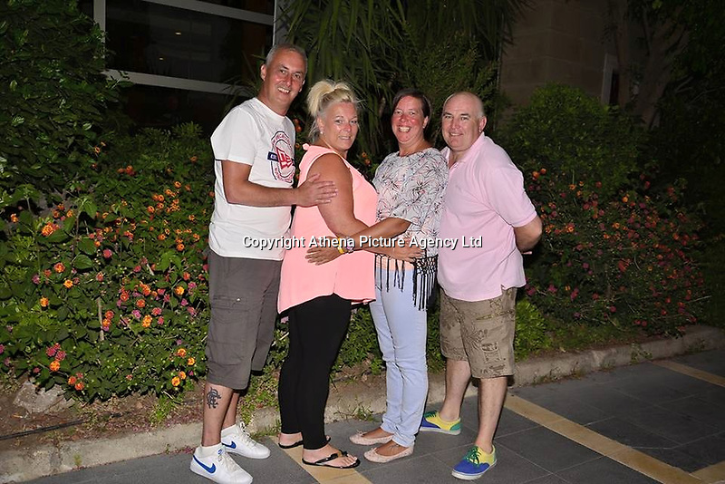 """Pictured: Tracy Kearns (3rd L) with Anthony Bird (4th L)<br /> Re: A man strangled his partner and wrapped her body in plastic, after discovering she was having an affair, Mold Crown Court has heard.<br /> 48 year old Anthony Bird, then covered the body of 43 year old Tracy Kearns in debris in a trailer.<br /> Mr Bird denies the murder at their home in Kinmel Bay, in May this year, but accepts responsibility for her death.<br /> He """"attacked and strangled"""" his partner, prosecutor Ian Unsworth said opening the case.<br /> Mr Unsworth said the defendant misled police and even helped officers in the search for the mother-of-two, telling """"lie after lie"""".<br /> The couple had been in a relationship for seven years and had two daughters together.<br /> They both worked at the Sandy Cove Club in Kinmel Bay but Mr Unsworth said things deteriorated and she started a relationship with another man, Andrew Jones."""