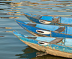 Guardian Eyes - Boats on the Thu Bon river, Hoi An, Viet Nam