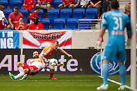 Brandon Barklage (25) of the New York Red Bulls and Andrew Driver (20) of the Houston Dynamo. The New York Red Bulls defeated the Houston Dynamo 2-0 during a Major League Soccer (MLS) match at Red Bull Arena in Harrison, NJ, on June 30, 2013.