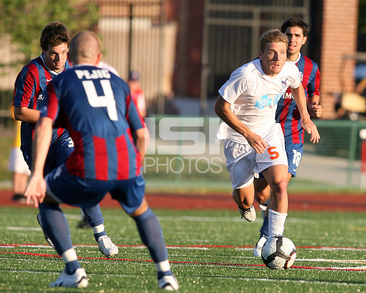 Shaun Pejic #4 of Crystal Palace Baltimore waits for Floyd Franks #5 of the Carolina Railhawks during an NASL match at Paul Angelo Russo Stadium in Towson, Maryland on September 18 2010. Carolina won 4-2.