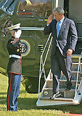 Washington, D.C. - May 21, 2005 -- United States President George W. Bush salutes his Marine Guard as he arrives at the White House in Washington, DC aboard Marine One on May 21, 2005.  He addressed the Calvin College Commencement in Grand Rapids, Michigan earlier in the day.<br /> Credit: Ron Sachs  - Pool via CNP