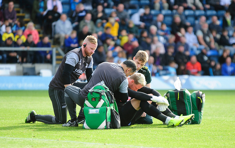 Wycombe Wanderers' Ryan Allsop receives treatment after a clash with Lincoln City's John Akinde<br /> <br /> Photographer Andrew Vaughan/CameraSport<br /> <br /> The EFL Sky Bet League One - Wycombe Wanderers v Lincoln City - Saturday 7th September 2019 - Adams Park - Wycombe<br /> <br /> World Copyright © 2019 CameraSport. All rights reserved. 43 Linden Ave. Countesthorpe. Leicester. England. LE8 5PG - Tel: +44 (0) 116 277 4147 - admin@camerasport.com - www.camerasport.com