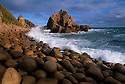Australia, Victoria, Phillip Island, Cape Wollamai, The Pinnacles rocky outcrops, rounded pebbles in foreground