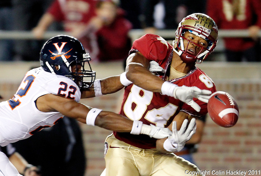 TALLAHASSEE, FL 11/19/11-FSU-UVA111911 CH-Florida State's Rodney Smith can't hang on to what could have been the winning touchdown as Virginia's Drequan Hoskey defends in the final minute of the game Saturday at Doak Campbell Stadium in Tallahassee. The Seminoles lost to the Cavaliers 14-13..COLIN HACKLEY PHOTO