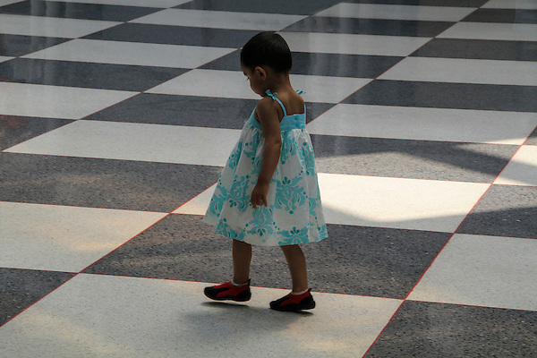 Girl walking in building lobby, Colorado, .  John offers private photo tours in Denver, Boulder and throughout Colorado. Year-round Colorado photo tours.