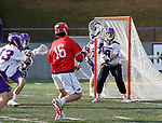 UAlbany Men's Lacrosse defeats Stony Brook on March 31 at Casey Stadium.  Owen Daly (#16) shoots on JD Colarusso (#9).