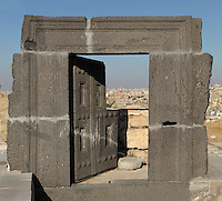 Carved door in black basalt, possibly Nabatean, Amman Citadel, Jabal al-Qal'a, Amman, Jordan. Amman cityscape visible in the background. Picture by Manuel Cohen