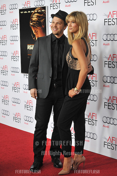 Delta Goodrem &amp; Gavin DeGraw at the Los Angeles premiere of &quot;Out of the Furnace&quot;, part of the AFI Fest 2013, at the TCL Chinese Theatre, Hollywood.<br /> November 9, 2013  Los Angeles, CA<br /> Picture: Paul Smith / Featureflash