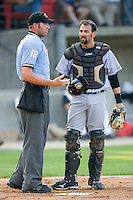 Catcher Chris Hatcher #36 of the Jacksonville Suns argues a call with home plate umpire Travis Carlson during a Southern League game against the Carolina Mudcats at Five County Stadium May 15, 2010, in Zebulon, North Carolina.  Photo by Brian Westerholt /  Seam Images
