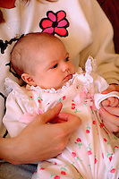 Newborn baby girl age 3 months being held by mother.  Burnsville Minnesota USA