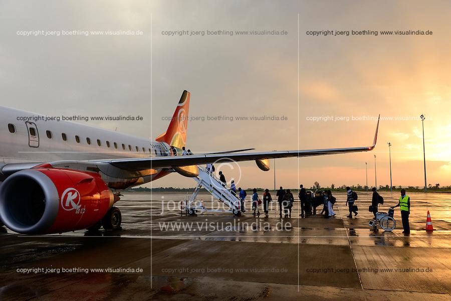 KENYA, Nairobi, JKIA Jomo Kenyatta International airport, passenger board a Kenya Airways aircraft Embraer 190 during sunset after a rain shower