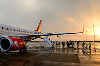 KENYA, Nairobi, JKIA Jomo Kenyatta International airport, passenger board a Kenya Airways aircraft Embraer 190 during sunset after a rain shower