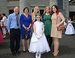 Aobhín McGeogh with her mother Roisín, aunties Laura and Lisa and grandparents Gerard and Kathleen after she made her First Communion at the Lourdes Church on Saturday. www.newsfile.ie