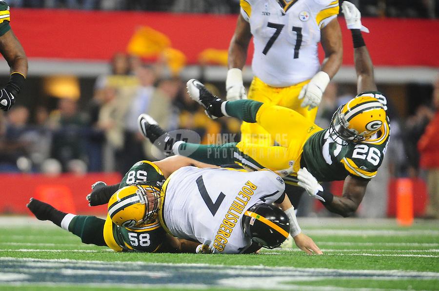 Feb 6, 2011; Arlington, TX, USA; Pittsburgh Steelers quarterback Ben Roethlisberger (7) is tackled by Green Bay Packers safety Charlie Peprah (26) and linebacker Frank Zombo (58) during Super Bowl XLV at Cowboys Stadium.  Mandatory Credit: Mark J. Rebilas-
