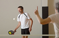NWA Democrat-Gazette/BEN GOFF @NWABENGOFF<br /> Brad Tew of Rogers returns the ball on Monday Nov. 16, 2015 while practicing pickleball at the City of Rogers Senior Wellness Center.