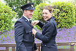 23/7/2015.    Graduating from the Garda College in Templemore this Thursday were Garda Jane Buckley, Tullamore who is stationed at Finglas helps adjust her Garda husband Paul's uniform.  Garda Paul Buckley graduated ten years ago.<br /> Photograph Liam Burke/Press 22