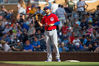 Buffalo Bisons first baseman Rowdy Tellez (21) catches a throw between innings of the game against the Durham Bulls at Durham Bulls Athletic Park on April 30, 2017 in Durham, North Carolina.  The Bisons defeated the Bulls 6-1.  (Brian Westerholt/Four Seam Images)
