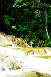 Jamaica: Climbing Dunn's River Falls. photo: jamaic104 .Photo copyright Lee Foster, www.fostertravel.com, 510/549-2202, lee@fostertravel.com