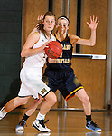 FEBRUARY 14, 2015 -- Taylor Trohkimoined #11 of Black Hills State gets turned by  defender Christina Whitelaw #4 of Colorado Christian during their Rocky Mountain Athletic Conference women's basketball game Saturday at the Donald E. Young Center in Spearfish, S.D.  (Photo by Dick Carlson/Inertia)