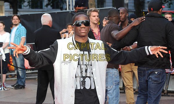 "TINCHY STRYDER (Kwasi Danquah).The Gala Premiere of ""The Karate Kid"", Odeon Leicester Square, London, England, UK..15th July 2010.half length black sunglasses shades white slogan sleeve jacket hands arms outstretched baseball jersey grey gray jacket  .CAP/BEL.©Tom Belcher/Capital Pictures."