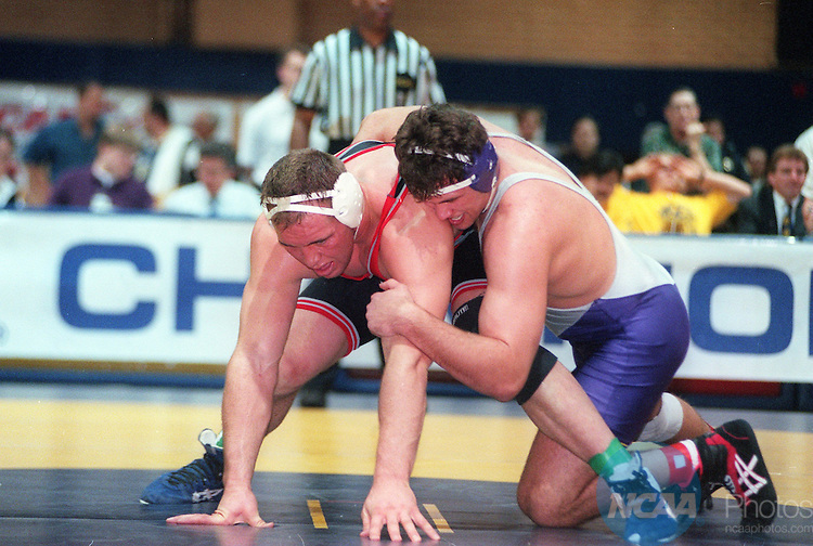 Caption: Tony Kenning of Mankato State takes on Shane Carwin of Western State in the Heavyweight weight class of the Division 2 Wrestling Championship March 16, 1996, in Greeley, CO. Kenning defeated Carwin and took home the championship title. Crissy Pascual/NCAA Photos