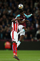 Bruno Martins Indi of Stoke City and Edimilson Fernandes of West Ham United during West Ham United vs Stoke City, Premier League Football at The London Stadium on 16th April 2018