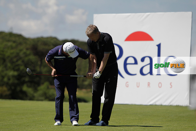 Paul McGinley (IRL) assisting David Moyes (AM) during the Pro-Am in The Open De Espana at The PGA Catalunya Resort on Wednesday 14th May 2014.<br /> Picture:  Thos Caffrey / www.golffile.ie