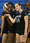 Marymount's Morgan McAlpin and Erin Allison talk on the sidelines before a college volleyball game, in Arlington, Vir., on Saturday, Nov. 1, 2014.<br /> Photo by Cathleen Allison