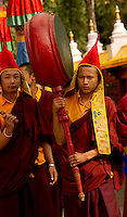 Buddhist Monk playing a drum in a Losar ceremonial procession, Sikkim, India