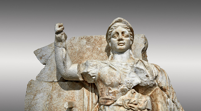 Close up of a Roman Sebasteion  relief  sculpture of Roma armed, Aphrodisias Museum, Aphrodisias, Turkey.<br /> <br /> Roma is equipped with a spear, helmet, round shield and imperial style armour. Blow crouches a naked bearded prisoner, with hands tied behind his back and a skin knotted around his neck. He turns to look up at Roma