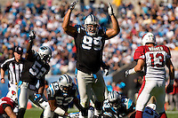 Carolina Panthers defensive tackle Maake Kemoeatu (99) celebrates a tackle against the Arizona Cardinals during an NFL football game at Bank of America Stadium in Charlotte, NC.