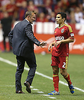 Head coach of Real Salt Lake Jason Kreis talks to Tony Beltran #2 during a game against D.C. United during the first half of the U.S. Open Cup Final on October  1, 2013 at Rio Tinto Stadium in Sandy, Utah.