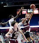 UNCASSVILLE, CT-031818JS01- Sacred Heart's Isiah Gaiter (2) puts up a shot over Notre Dame-Fairfield's Damion Medwinter (1) during their Division I championship game Sunday at Mohegan Sun Arena. <br /> Jim Shannon Republican-American