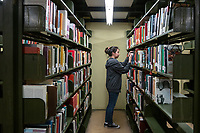 Rebecca Quiñonez '21 shelves a book while working in the library<br /> Occidental College students study for finals and write papers during finals week in the Academic Commons/Mary Norton Clapp Library, Monday, May 6, 2019.<br /> (Photo by Marc Campos, Occidental College Photographer)