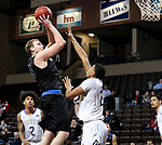 SIOUX FALLS, SD - MARCH 12:  Bryce Lienhoop #23 from St. Francis shoots over Aziz Leeks #22 from the College of Idaho during their semifinal game at the 2018 NAIA DII Men's Basketball Championship at the Sanford Pentagon in Sioux Falls. (Photo by Dave Eggen/Inertia)