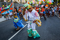 "RIO DE JANEIRO, BRAZIL - FEBRUARY 23, 2014: Luiz Claudio, 41, dances as outpatients of the Instituto Philippe Pinel psychiatric hospital, family and their friends celebrate during the annual Tá Pirando, Pirado, Pirou! carnival street parade on February 23, 2014 in Rio De Janeiro, Brazil. It looks like any of the other 450 or so street parties, locally called ""carnival blocks,"" that parade through Rio de Janeiro during the raucous pre-Lenten festivities that draw hundreds of thousands to the city each year. What makes this party different are its performers and organizers: psychiatric patients and their doctors, therapists, family members, neighbors and passers-by. The group, called Tá Pirando, Pirado, Pirou!, which roughly translates as ""We're freaking out, we already freaked out!"", began ten years ago when Brazil was in the process of dismantling its century-old system of mental asylums. A law passed in 2001 called for long-term outpatient psychiatric care to be offered primarily in community clinics. The number of such clinics increased more than fivefold in the following decade, while the number of asylum beds for psychiatric patients dropped 40 percent nationwide.<br /> <br /> Daniel Berehulak for The New York Times"