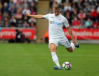 Stephen Kingsley of Swansea City takes a free kick during the Premier League match between Swansea City and Hull City at the Liberty Stadium, Swansea on Saturday August 20th 2016