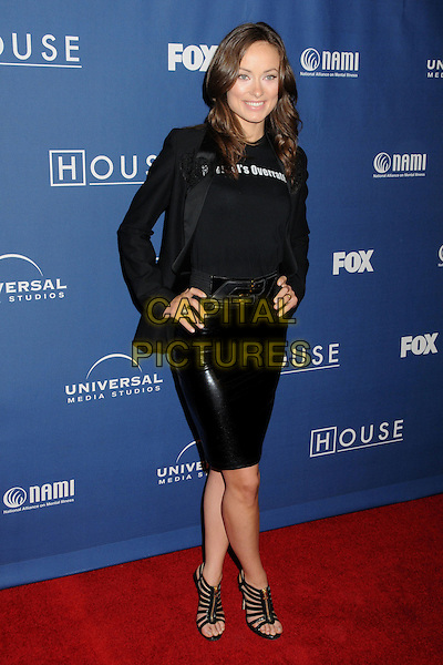 "OLIVIA WILDE.""House"" 100th Episode Party at STK, Los Angeles, California, USA..January 21st, 2009.full length top jacket skirt pvc hands on hips leather shiny strappy zip zipper sandals shoes black normal's overrated .CAP/ADM/BP.©Byron Purvis/AdMedia/Capital Pictures."