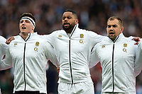 Tom Curry, Joe Cokanasiga and Ben Moon of England sing the national anthem. Guinness Six Nations match between England and Italy on March 9, 2019 at Twickenham Stadium in London, England. Photo by: Patrick Khachfe / Onside Images