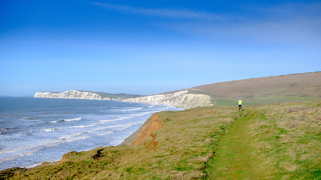 Running along the Isle of Wight coastal path at Compton Bay