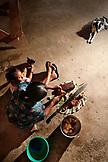 BELIZE, Punta Gorda, Toledo District, Desiree Mes prepares a chicken for lunch in her home, San Jose Maya Village