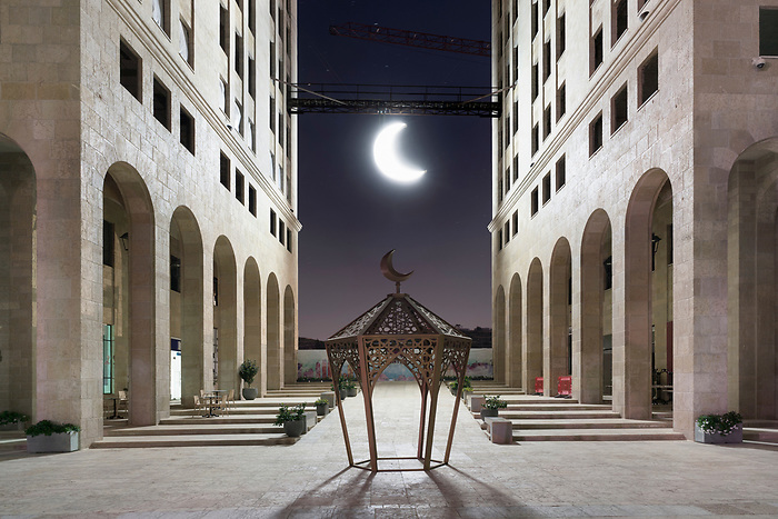 "Apr 2018. The ""Q center"" decorated with the traditional symbols of Ramadan: The lantern and the moon."