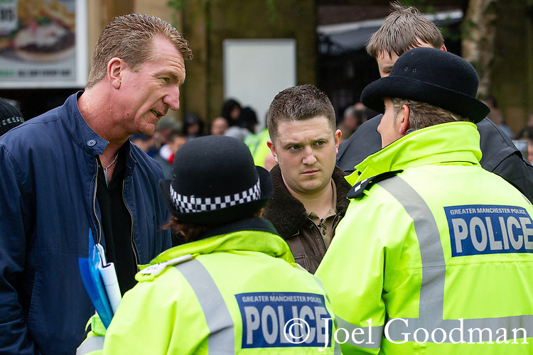 © Joel Goodman - 07973 332324 . 09/06/2012. Rochdale , UK. EDL Deputy Leader KEVIN CARROLL and Leader TOMMY ROBINSON (aka Stephen Yaxley-Lennon ) talk with police ahead of the demonstration . The English Defence League ( EDL ) hold a march and rally in Rochdale Town Centre . Photo credit : Joel Goodman