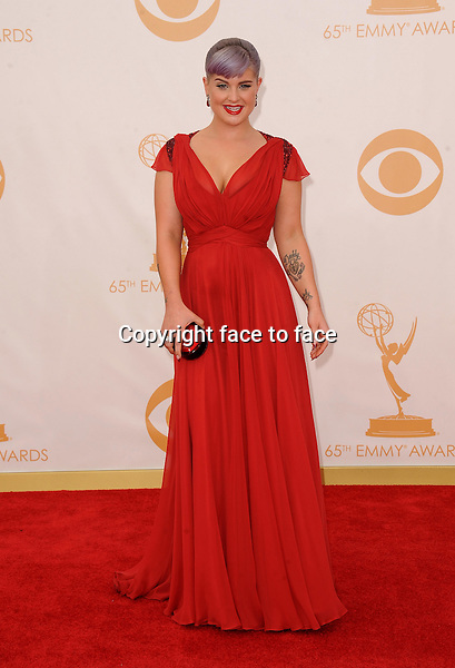 Kelly Osbourne arrives at the 65th Primetime Emmy Awards at Nokia Theatre on Sunday Sept. 22, 2013, in Los Angeles.<br />