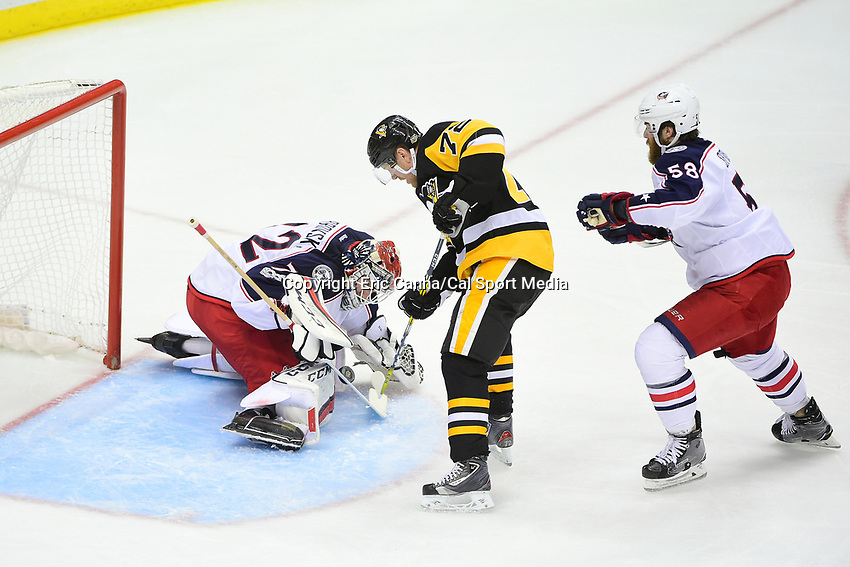 Thursday, April 20, 2017: Pittsburgh Penguins right wing Patric Hornqvist (72) battles for the rebound off of Columbus Blue Jackets goalie Sergei Bobrovsky (72) during game 5 of round one of the National Hockey League Eastern Conference Stanley Cup Playoffs between the Columbus Blue Jackets and the Pittsburgh Penguins, held at PPG Paints Arena, in Pittsburgh, PA. Pittsburgh defeats Columbus 5-2 to win the best of seven series 4 games to 1and advances to round two of the Eastern Conference Playoffs. Eric Canha/CSM