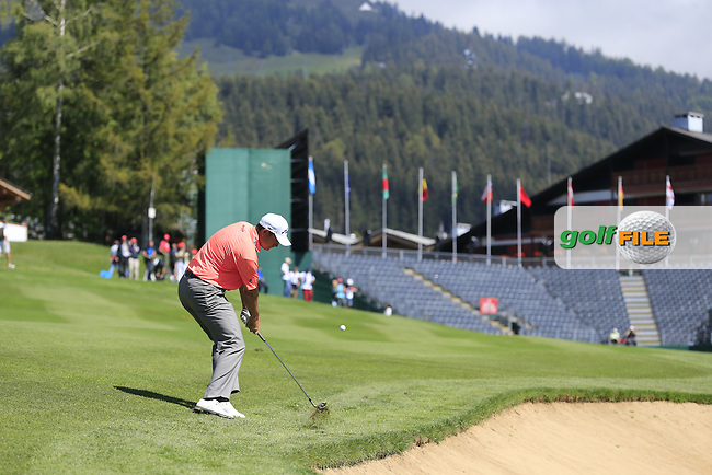 David HOWELL (ENG) plays his 2nd shot on the 18th hole during Saturday's Round 3 of the 2014 Omega European Masters held at the Crans Montana Golf Club, Crans-sur-Sierre, Switzerland.: Picture Eoin Clarke, www.golffile.ie: 6th September 2014