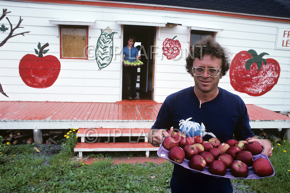 Ile D'Orleans, Quebec City Area, Canada, June 8, 1984. Two local farmers showing their apple production.
