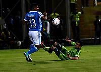 BOGOTA - COLOMBIA -25 - 11 - 2017: Jhon Cano (Der.) jugador de La Equidad disputa el balón con Harold Mosquera (Izq.) jugador de Millonarios, durante partido de ida entre La Equidad y Millonarios, de los cuartos de final la Liga Aguila II - 2017, jugado en el estadio Metropolitano de Techo de la ciudad de Bogota. / Jhon Cano (R) player of La Equidad vies for the ball with Harold Mosquera (L) player of Millonarios, during a match for the first leg between La Equidad and Millonarios, to the quarter of finals for the Liga Aguila II - 2017 at the Metropolitano de Techo Stadium in Bogota city, Photo: VizzorImage  / Luis Ramirez / Staff.